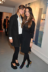 Left to right, CAROLYN HODLER and NATI BLASKOVICOVA at a Contemporary Art evening hosted by NUBA Art Ltd entitles 'It's a Material World' held at London West Bank Gallery, 133-137 Westbourne Grove, London W11 on 1st December 2011.