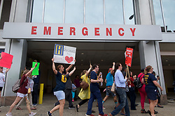Protestors march around the building after a rally with Bernie2020 campaign co-chair Sen. Nina Turner to protest the the imminent closure of Hahnemann University Hospital in Philadelphia, PA on July 11, 2019. The struggling Center City located hospital announced it will seize operations and is facing out critical services like Emergency access and the maternity ward unless support is found to end the financial turmoil