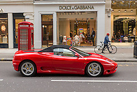 A Ferrari in front of the Dolce & Gabbana in Knightsbridge, London.