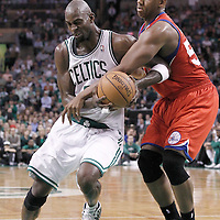 14 May 2012: Boston Celtics power forward Kevin Garnett (5) is fouled by Boston Celtics center Ryan Hollins (50) during the Philadelphia Sixers 82-81 victory over the Boston Celtics, in Game 2 of the Eastern Conference semifinals playoff series, at the TD Banknorth Garden, Boston, Massachusetts, USA.