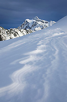 Mount Shuksan, 9,131 ft (2,783 m), with patterns of windblown snow or sastrugi in the foreground, North Cascades Washington
