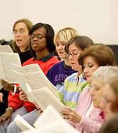 (left to right) Carla Ballou, Lillian Chambliss, Anita Campbell, Jill Lewis, Pat Armstrong, Ellen Barnett and Donita Carman are some of the women of the Dayton Philharmonic Chorus rehearsing for their upcoming performance of Mahler's Third Symphony, Tuesday, January 2, 2007.