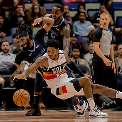 Jan 7, 2019; New Orleans, LA, USA; New Orleans Pelicans guard Elfrid Payton (4) and Memphis Grizzlies guard Mike Conley (11) battle for a loose ball during the second quarter at the Smoothie King Center. Mandatory Credit: Derick E. Hingle-USA TODAY Sports