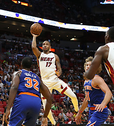 October 24, 2018 - Miami, FL, USA - The Miami Heat's Rodney McGruder, middle, floats the ball over the heads of the New York Knicks defense in the first half on Wednesday, Oct. 24, 2018, at the American Airlines Arena in Miami. The Heat won, 110-88. (Credit Image: © Carl Juste/Miami Herald/TNS via ZUMA Wire)