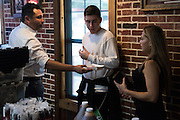 Oscar De La Hoya shares bbq with his son, Devon, and his assistant at Meat U Anywhere BBQ in Grapevine, Texas on September 16, 2016.  (Cooper Neill for ESPN)