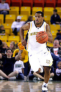 25 November 2005: Marquette Golden Eagle Dominic James (1), a freshman, brings the ball up the court in the Marquette University 73-70 victory over Oral Roberts University at the Great Alaska Shootout in Anchorage, Alaska