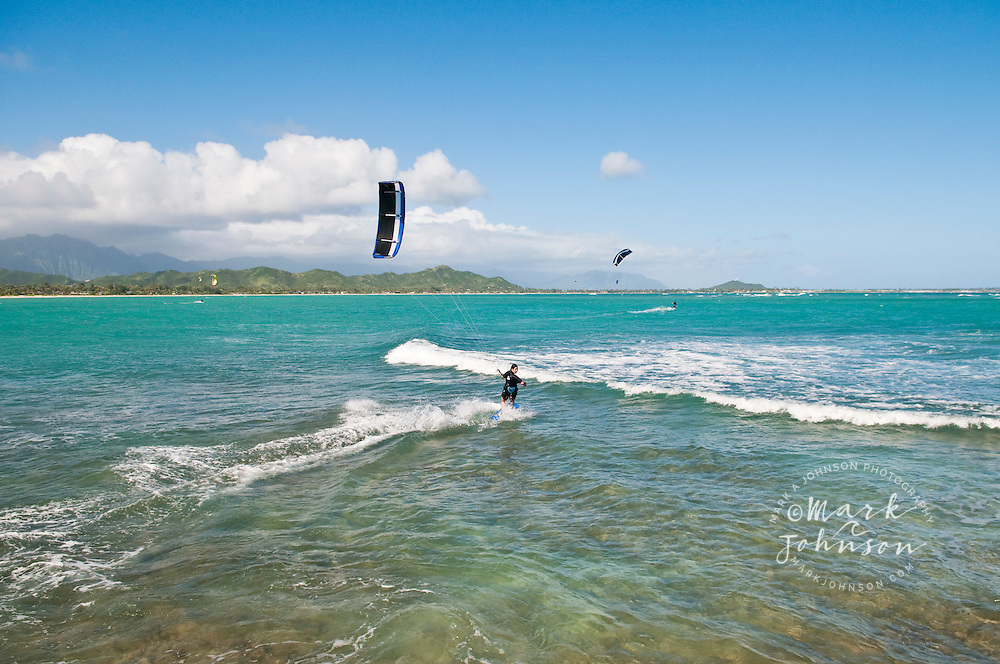 Woman kitesurfing off Flat Island, Kailua Bay, Oahu, Hawaii