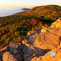"View of the Atlantic Ocean from the trail on ""The Beehive"" in fall in Maine's Acadia National Park."