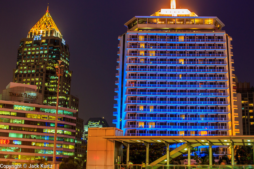 15 OCTOBER 2012 - BANGKOK, THAILAND:  The Dusit Thani Hotel in the foreground with the Olympia Thai Building in the background in Bangkok, Thailand. With a population of about 12 million, Bangkok is one of the fastest growing cities in the world.    PHOTO BY JACK KURTZ