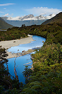 The Haast River flows through a wide river valley from the Southern Alps in New Zealand's South Island.