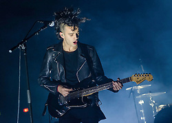 "© Licensed to London News Pictures. 09/01/2014. London, UK.   The 1975 performing live at Brixton Academy.  In this picture - Matthew Healy. The 1975 are an English alternative rock/indie rock band from consisting of members Matthew Healy (vocals, guitar), Adam Hann (guitar), George Daniel (drums), and Ross MacDonald (bass).  They are touring to promote their debut studio album ""The 1975"".  Photo credit : Richard Isaac/LNP"