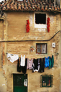 House with drying red peppers and laundry in the Casco Antiguo (old town) of Haro, Rioja, Spain.