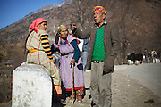 Local people from Kullu in their traditional attire, chatting near Kais village of Kullu, Himachal Pradesh.