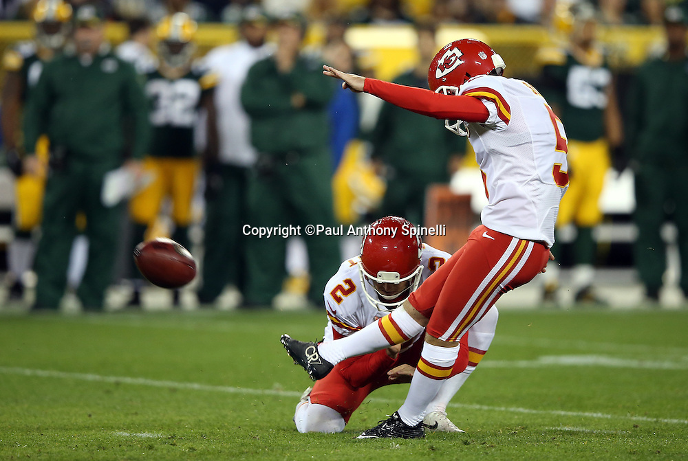 Kansas City Chiefs punter Dustin Colquitt (2) holds while Kansas City Chiefs kicker Cairo Santos (5) kicks an extra point that cuts the Green Bay Packers second quarter lead to 14-7 during the 2015 NFL week 3 regular season football game against the Green Bay Packers on Monday, Sept. 28, 2015 in Green Bay, Wis. The Packers won the game 38-28. (©Paul Anthony Spinelli)