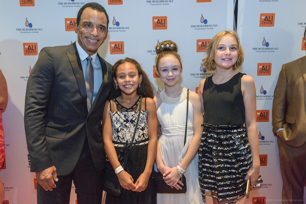 Multi-Grammy Award-winner Jon Secada with young ladies on the red carpet at the fourth annual Muhammad Ali Humanitarian Awards Saturday, Sept. 17, 2016 at the Marriott Hotel in Louisville, Ky. (Photo by Brian Bohannon for the Muhammad Ali Center)