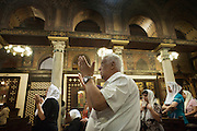 Christians worshippers in the Hanging Church Al Moallaqa attend a mass.