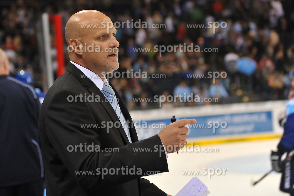 03.10.2011,  O2 World, Hamburg, GER, DEL, Hamburg Freezers vs Iserlohn Roosters, im Bild Trainer Benoit Laporte (Hamburg) spricht mit dem Schiedsrichter. // during match at O2 World 2011/10/03, Hamburg  EXPA Pictures © 2011, PhotoCredit: EXPA/ nph/  Witke       ****** out of GER / CRO  / BEL ******