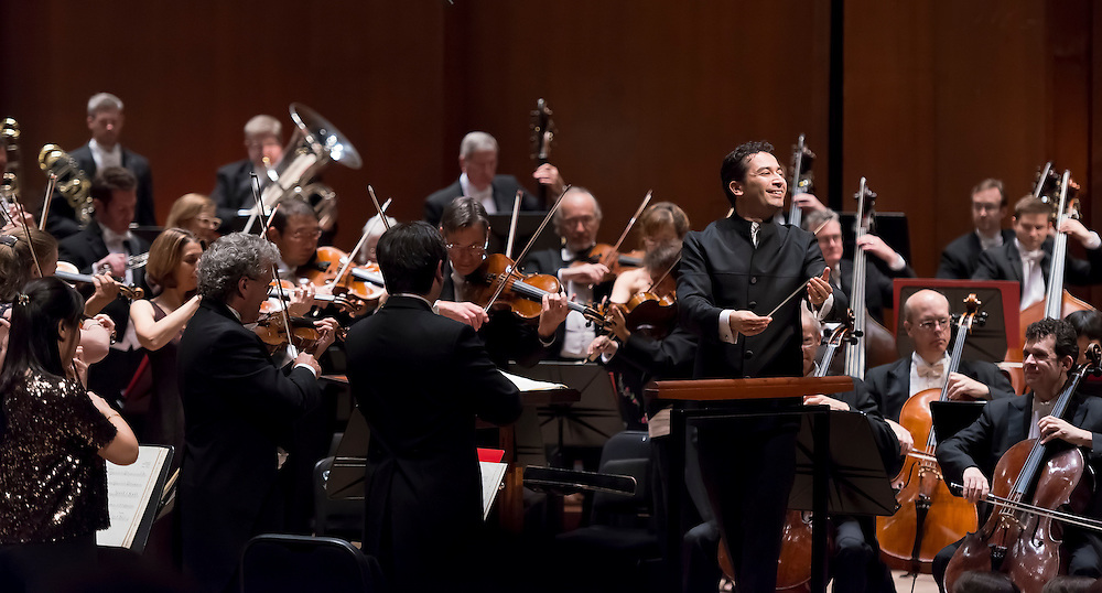 Andrés Orozco-Estrada takes a moment to smile at the audience as he conducts The Houston Symphony in Stravinsky's mythical ballet, The Firebird.