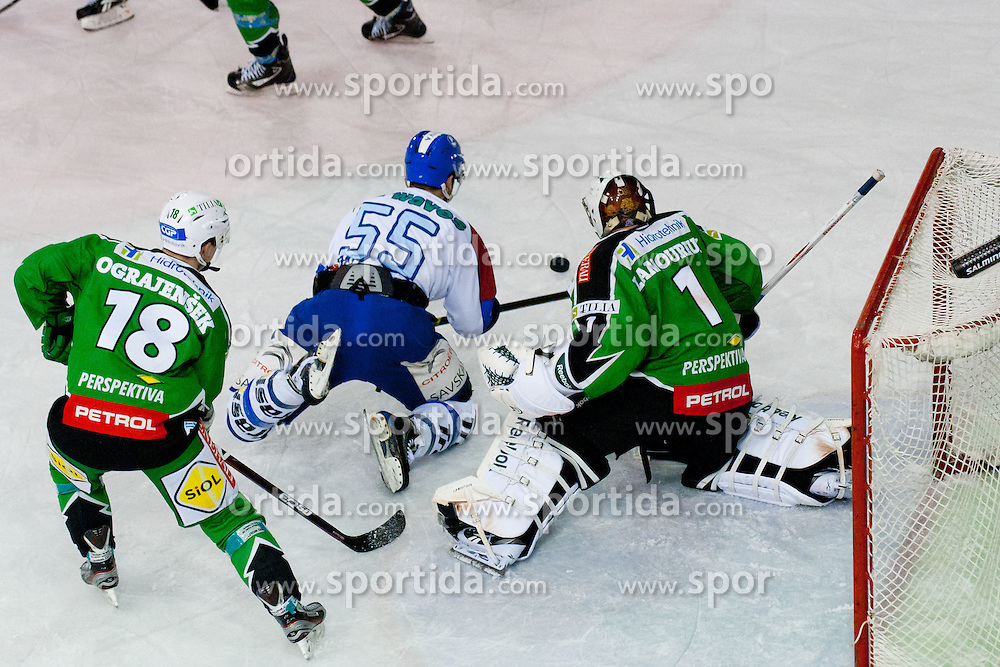 Pascal Morency (KHL Medvescak Zagreb, #55) vs Ken Ograjensek (HDD Tilia Olimpija, #18) and Jean-Philippe Lamoureux (HDD Tilia Olimpija, #1) during ice-hockey match between HDD Tilia Olimpija and KHL Medvescak Zagreb in 30th Round of EBEL league, on December 9, 2011 at Hala Tivoli, Ljubljana, Slovenia. (Photo By Matic Klansek Velej / Sportida)