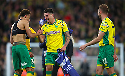 Norwich City's Jamal Lewis (left) and Norwich City's Ben Godfrey celebrate promotion after the final whistle of the Sky Bet Championship match at Carrow Road, Norwich.