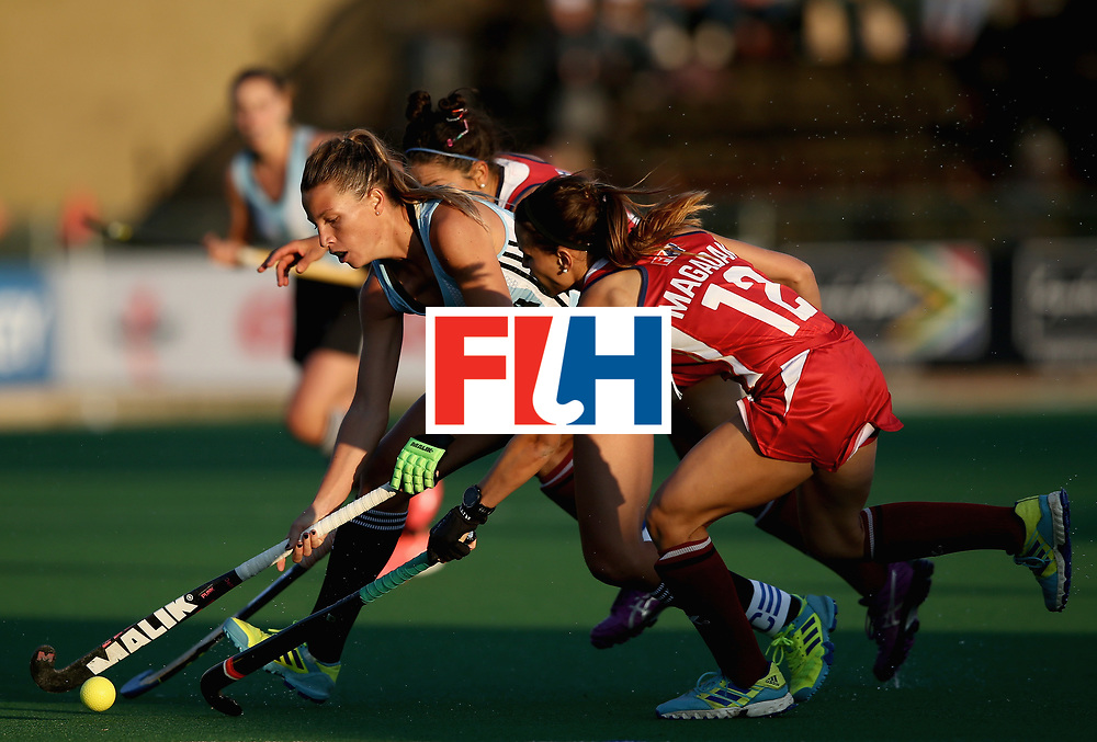 JOHANNESBURG, SOUTH AFRICA - JULY 14: Delfina Merino of Argentina and Amanda Magadan of the United States battle for possession during day 4 of the FIH Hockey World League Semi Finals Pool B match between the United States and Argentina at Wits University on July 14, 2017 in Johannesburg, South Africa. (Photo by Jan Kruger/Getty Images for FIH)