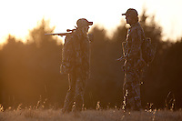 man and woman deer hunter talking after a hunt
