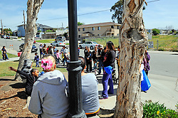 Food recipients form a line to pick up basics at a La Paz Park distribution point. The site is managed by Celebration Worship and supplied by the Food Bank of Monterey County.