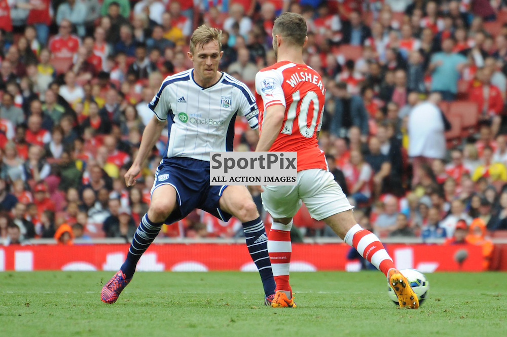 Arsenals Jack Wilshere and West Broms Darren Fletcher in action during the Arsenal v West Brom match on Sunday 24th May 2015