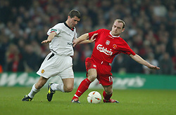 CARDIFF, WALES - Sunday, March 2, 2003: Liverpool's Danny Murphy  and Manchester United's Roy Keane during the Football League Cup Final at the Millennium Stadium. (Pic by David Rawcliffe/Propaganda)