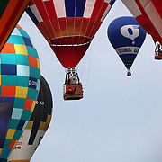 Stephane Bolze, France, (centre, left), takes to the skies around rural Michigan near Battle Creek as balloons launch during the World Hot Air Ballooning Championships. Battle Creek, Michigan, USA. 19th August 2012. Photo Tim Clayton
