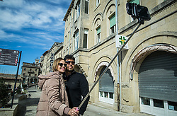 Couple making selfie in City of San Marino, on October 12, 2015 in Republic of San Marino. Photo by Vid Ponikvar / Sportida
