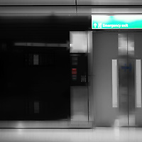 The glossy automatic door of an elevator is used as the emergency exit.
