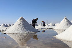 November 1, 2018 - Zhangye, Zhangye, China - Zhangye,CHINA-Workers at the Gaotai Salt Lake in Zhangye, northwest China's Gansu Province. The Gaotai Salt Lake, located in Gaotai County, is the oldest salt lake in Gansu Province. (Credit Image: © SIPA Asia via ZUMA Wire)