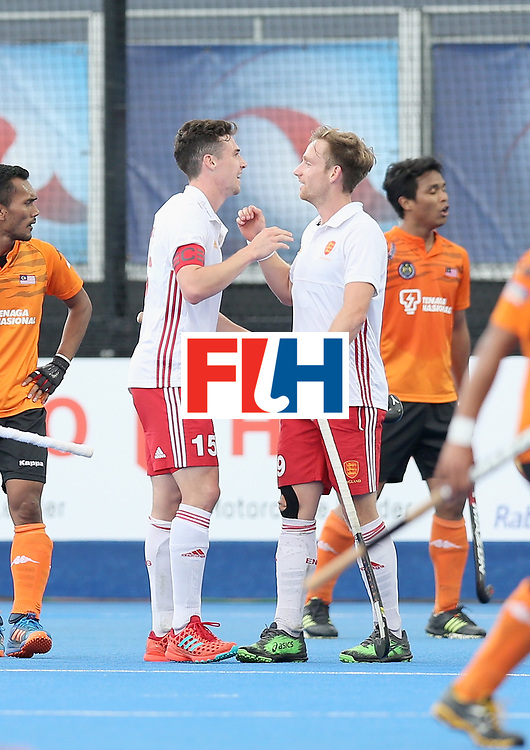 LONDON, ENGLAND - JUNE 25:  Phil Roper of England celebrates scoring their teams fourth goal with teammates during the 3rd/4th place match between Malaysia and England on day nine of the Hero Hockey World League Semi-Final at Lee Valley Hockey and Tennis Centre on June 25, 2017 in London, England.  (Photo by Alex Morton/Getty Images)