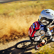 Micah Goodrich rides Highschool Butte in Jackson Wyoming in late afternoon light.