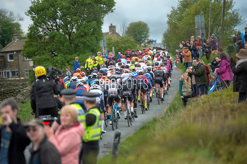 The peloton after the summit of Cote de Goose Eye during stage four of the Tour de Yorkshire from Halifax to Leeds, , United Kingdom on 4 May 2019.