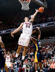 Virginia forward/center Ryan Pettinella (34) grabs a rebound against Drexel.  The #23 Virginia Cavaliers men's basketball team defeated Drexel Dragons 72-58 at the John Paul Jones Arena in Charlottesville, VA on November 20, 2007.