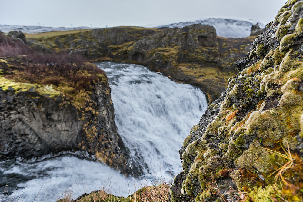 One of many waterfalls, covered with moss, Fludir, Iceland.