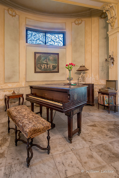 A music parlor in a formally grand home in the Vedado area of Havana, Cuba. The home was built in 1926.
