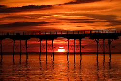 © Licensed to London News Pictures. <br /> 28/08/2017<br /> SALTBURN-BY-THE-SEA, UK.  <br /> The sun rises over the horizon between the legs of the pier in Saltburn-by-the-Sea on Bank Holiday Monday.<br />   <br /> Photo credit: Ian Forsyth/LNP