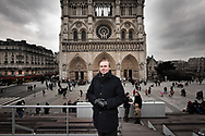 Civitas leader, Alain Escada poses for a portrait in front of Notre Dame cathedral in Paris.