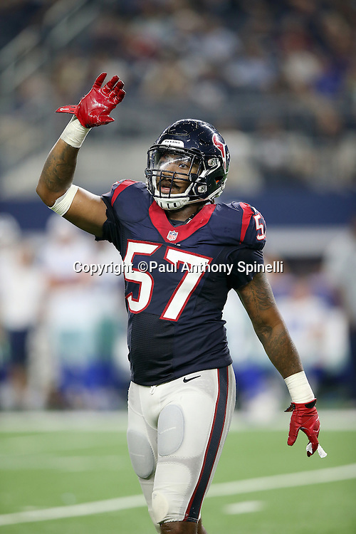 Houston Texans rookie inside linebacker Justin Tuggle (57) waves during the 2015 NFL preseason football game against the Dallas Cowboys on Thursday, Sept. 3, 2015 in Arlington, Texas. The Cowboys won the game 21-14. (©Paul Anthony Spinelli)