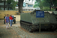 April 1993, American Atrocities Museum, Ho Chi Minh City, Vietnam --- Two Caucasian tourists look at an American tank in the American Atrocities Museum.  Ho Chi Minh City, Vietnam. --- Image by © Owen Franken/CORBIS