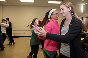 Abigail Morgan (left) and Madison Baimer do a turn while contradancing in their mathematics for educators class on Friday,  February 13. Their professor Javier Ronquillo uses the dancing to show his students a new way to teach math.