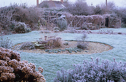The garden in winter. Looking over the gravel circle towards the vegetable garden.