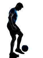 one caucasian man playing soccer juggling football player silhouette  in studio isolated on white background