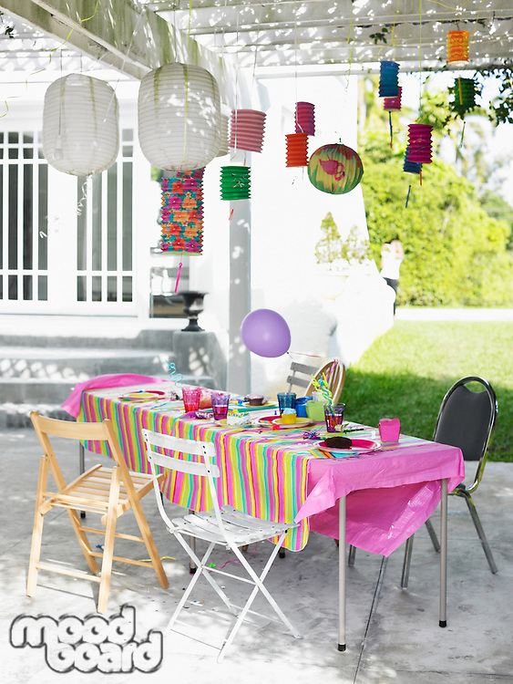 Table and decorated patio after birthday party