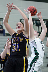 12 December 2015:  Maddie Merritt reaches for a rebound that bounced away from Autumn Hennes during an NCAA women's basketball game between the Wisconsin Stevens Point Pointers and the Illinois Wesleyan Titans in Shirk Center, Bloomington IL