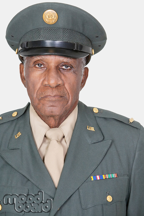 Portrait of a senior male US military officer over gray background