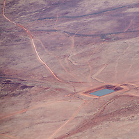 062513       Brian Leddy<br /> Cattle graze near a stock pond on the Big Boquillas Ranch near the Grand Canyon in this aerial photo from May 29.